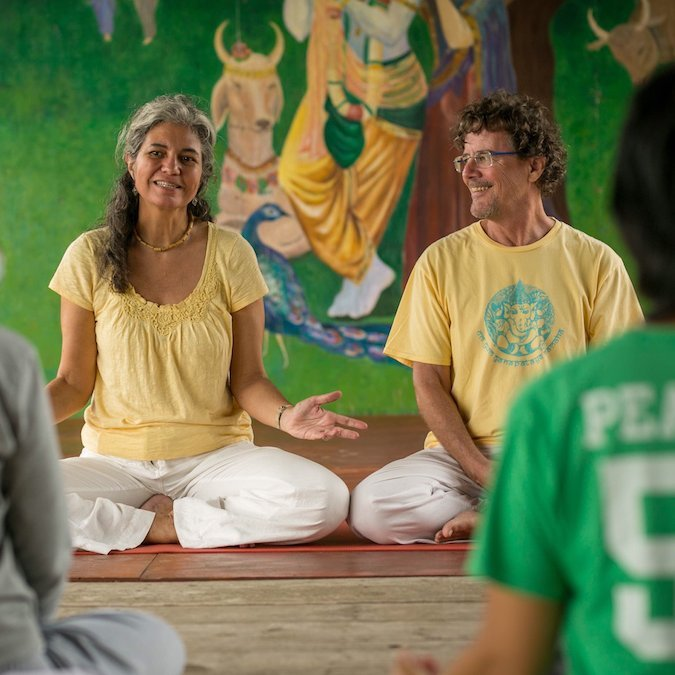 """<div style=""""line-height: 1.3; color: #ffffff; font-family: catamaran;"""">YOGA AND RELATIONSHIPS</br>with Mohini and Shyam</div>"""